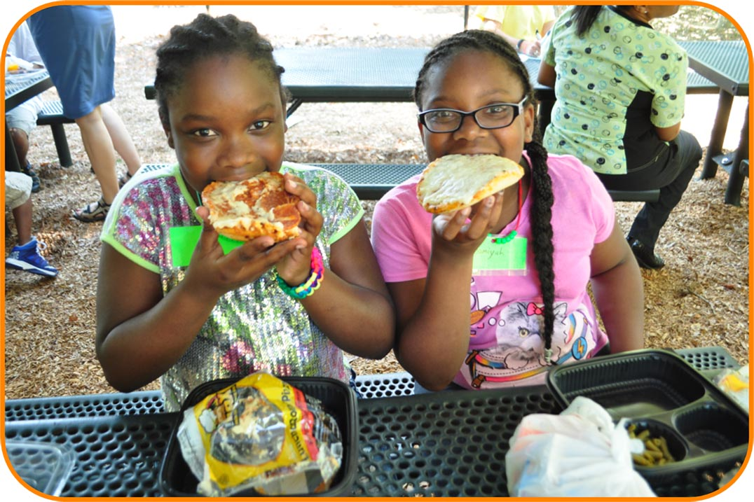 Two elementary school-aged girls having lunch at the Poe Center.