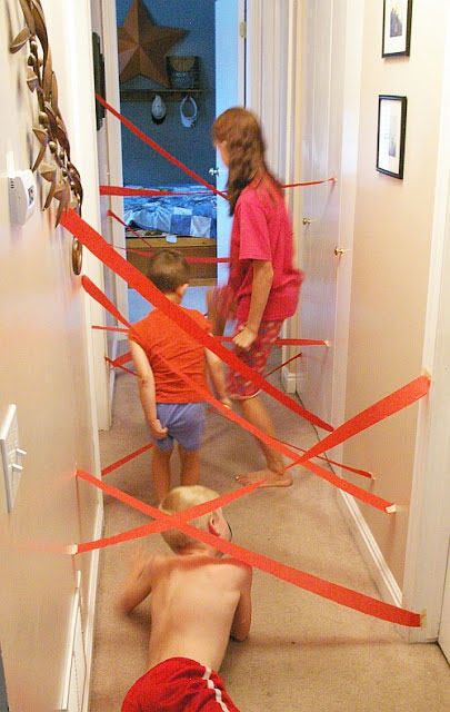 Kids playing with a homemade indoor maze.