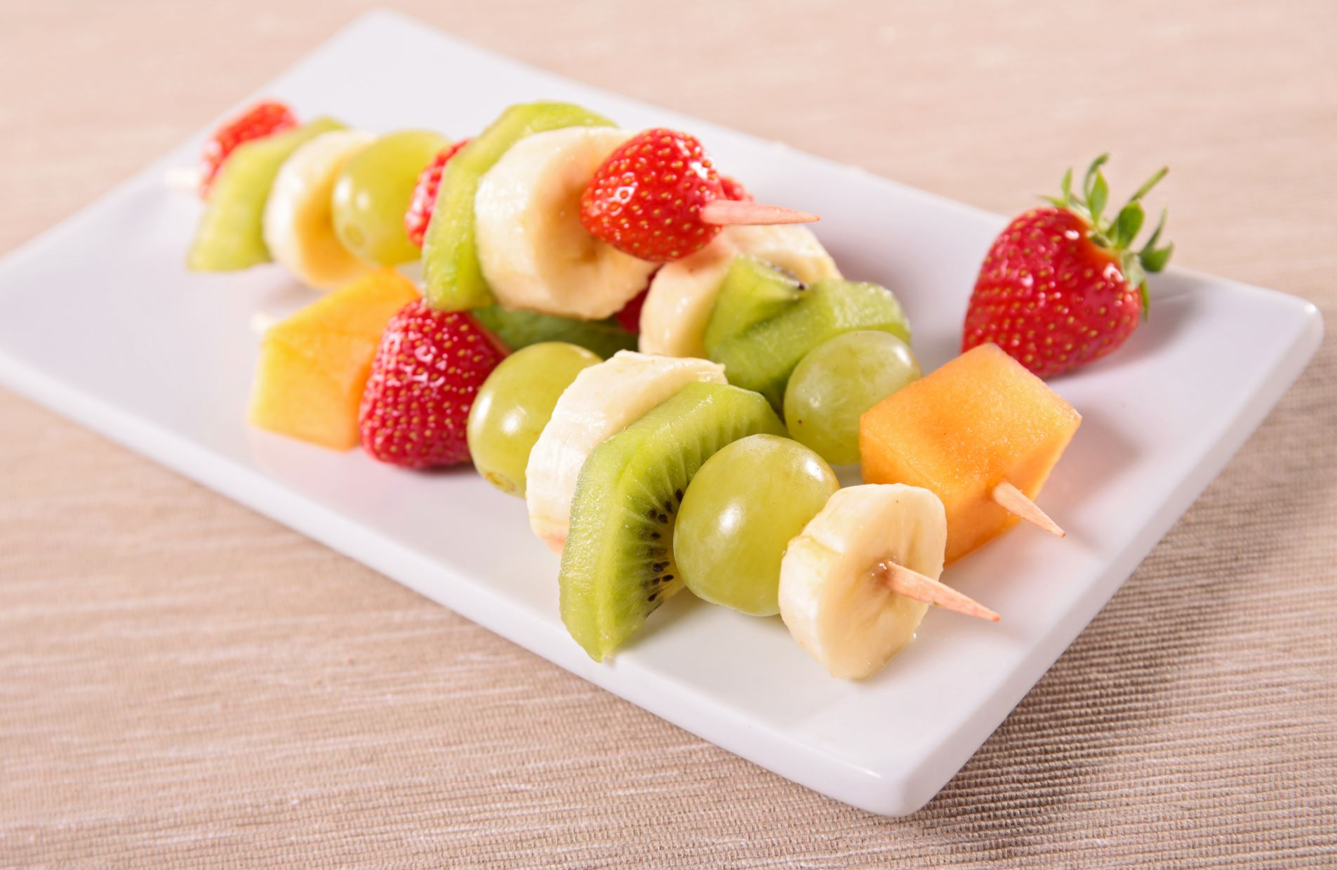 Pieces of colorful fruit on a skewer