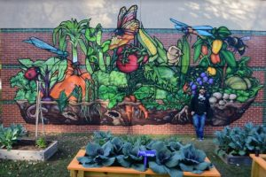 Completed garden mural with artist Sean Kernick.