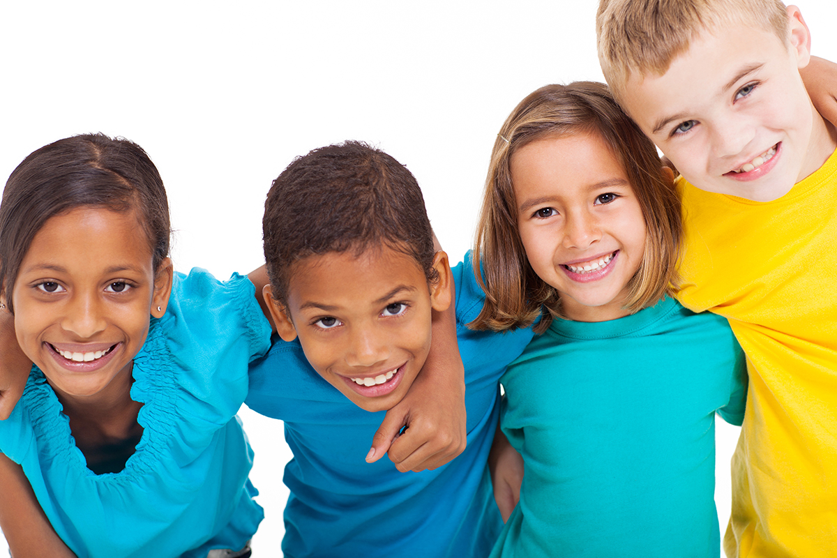 diverse children embracing